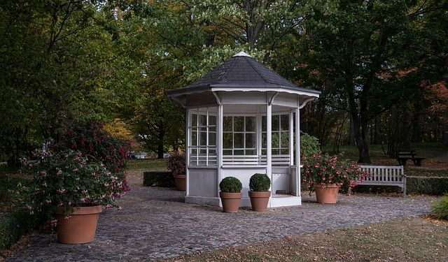 Another good idea for a creative Garden shed is to design it like a mini cottage, complete with a tiled roof and medium-sized glass windows